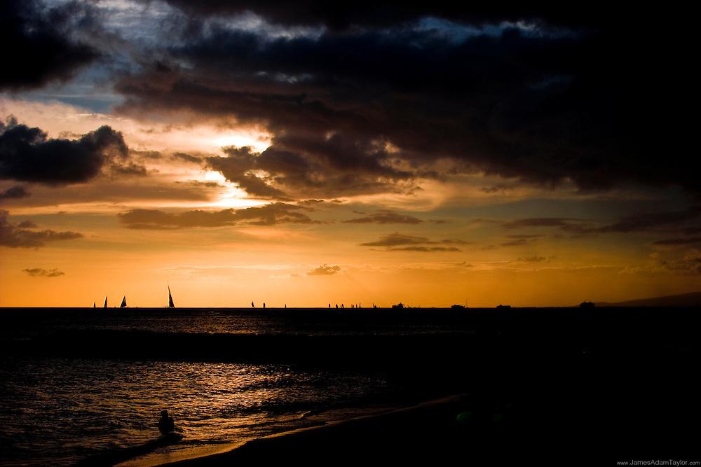 A dramatic sunset on Honolulu's Waikiki beach.