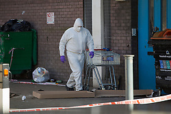 © licensed to London News Pictures. London, UK 17/02/2013. Forensic officer investigating where 16 year-old boy stabbed to death in Wandsworth, south London. Photo credit: Tolga Akmen/LNP