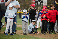 T Ball players from Price's Pools and the Irwin Zone watch opening day festivities from the pitcher's mound at Colby Field on Saturday morning.  (Karen Bobotas/for the Laconia Daily Sun)