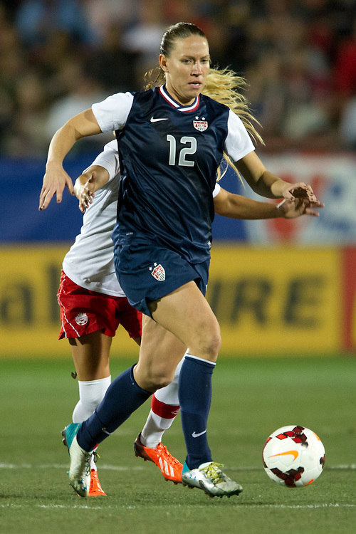 FRISCO, TX - JANUARY 31:  Lauren Holiday #12 of the U.S. Women's National Team controls the ball against the Canadian Women's National Team on January 31, 2014 at Toyota Stadium in Frisco, Texas.  (Photo by Cooper Neill/Getty Images) *** Local Caption *** Lauren Holiday