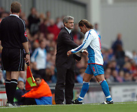 Photo: Back Page Images. 16/10/2004.<br /> Barclays Premiership. Blackburn Rovers v Middlesbrough. Ewood Park.<br /> Tuguy makes his way down the tunnel past manager Mark Hughes after being sent off