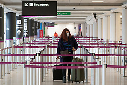Edinburgh, Scotland, UK. 15 Feb 2021. From today Scottish Government requires all passengers from overseas arriving at Scottish airports to go into a mandatory quarantine in a hotel. Pic; Female passenger checks in .Iain Masterton/Alamy Live news