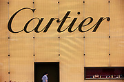 A man walks past a large Cartier display outside a high-end shopping mall in Shanghai, China, on October 01, 2011. China is by far the world's fastest growing market for luxury brands.