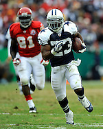October 11, 2009:   Running back Tashard Choice #23 of the Dallas Cowboys rushes past linebacker Tamba Hail #91 of the Kansas City Chiefs for a 36-yard touchdown in the third quarter at Arrowhead Stadium in Kansas City, Missouri.  The Cowboys defeated the Chiefs in overtime 26-20...
