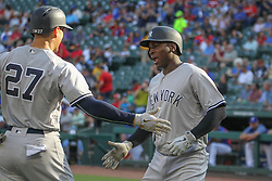 May 23, 2018 - Arlington, TX, U.S. - ARLINGTON, TX - MAY 23: New York Yankees shortstop Didi Gregorius (18) celebrates a home run during the game between the New York Yankees and the Texas Rangers on May 23, 2018 at Globe Life Park in Arlington, TX. (Photo by George Walker/Icon Sportswire) (Credit Image: © George Walker/Icon SMI via ZUMA Press)
