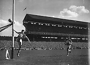 Goalkeeper kicks ball wide during the Down v Offaly All Ireland Senior Gaelic Football Final in Croke Park on 24th September 1961.