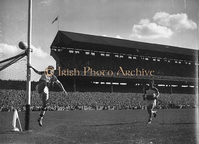 Goalkeeper kicks ball wide during the Down v Offaly All Ireland Senior Gaelic Football Final in Croke Park on 24th September 1961.