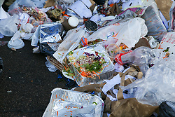 """© Licensed to London News Pictures. 20/12/2020. London, UK. A pile of rubbish and food waste on a pavement in Edmonton, north London as restaurants are providing take away service only. Prime Minister Boris Johnson announced on Saturday 19 December, that London and South East of England will move into Tier four restrictions. Under the new restrictions, non-essential shops, hairdressers and leisure and entertainment venues are closed, and a """"stay at home"""" message introduced. Photo credit: Dinendra Haria/LNP"""