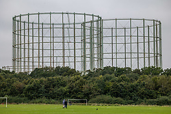 Licensed to London News Pictures. 07/10/2021. London, UK. Disused gas holders which were used in the 1930's to store domestic gas for local homes, tower over Motspur Park in south-west London as analysts predict that household energy bills could soar by £400 by next year as the wholesale price of gas hits new highs. Industry leaders have also warned that the high gas price, HGV lorry driver shortage and petrol stations running empty will have a kock-on effect and lead to higher prices for food in supermarkets. Photo credit: Alex Lentati/LNP