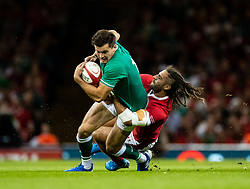 Jacob Stockdale of Irelandis tackled by Josh Navidi of Wales<br /> <br /> Photographer Simon King/Replay Images<br /> <br /> Friendly - Wales v Ireland - Saturday 31st August 2019 - Principality Stadium - Cardiff<br /> <br /> World Copyright © Replay Images . All rights reserved. info@replayimages.co.uk - http://replayimages.co.uk