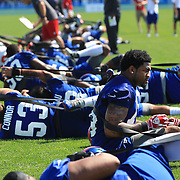Damontre Moore (right), during a stretching routine during the 2013 New York Giants Training Camp at the Quest Diagnostics Training Centre, East Rutherford, New Jersey, USA. 29th July 2013. Photo Tim Clayton.
