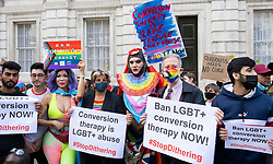 """LGBT+ protestors including Daniel Lismore, Jayne Ozanne, Rev Colin Coward and Peter Tatchell lead an anti Conversion Therapy demonstration outside The Cabinet Office, Whitehall, London, Great Britain <br /> 23rd June 2021 <br /> <br /> Members of the LGBT+ community, including Peter Tatchell tell the Government to """"stop dithering"""" over its promised ban on LGBT+ conversion therapy. It pledged to outlaw conversion therapy practices in the UK in 2018. <br /> <br /> <br /> Photograph by Elliott Franks"""