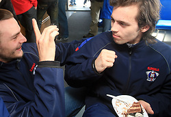 """Gregor Poloncic """"interviewing"""" David Rodman at whale watching boat when Poloncic (18), Golicic (17), Rebolj (27) and Razingar (9) were celebrating an anniversary of playing for Slovenian National Team for 100 (120) times, during IIHF WC 2008 in Halifax,  on May 07, 2008, sea at Halifax, Nova Scotia,Canada.(Photo by Vid Ponikvar / Sportal Images)"""
