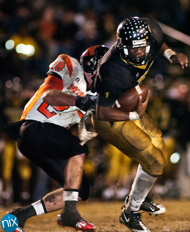 Concord's Dominique Posey breaks away from Northwest Cabarrus' Jonathan Wallace in the first round of the NCHSAA 3A Playoffs at Concord High School Friday Nov. 13, 2009. (photo by James Nix/Independent Tribune)