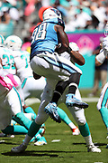 Tennessee Titans outside linebacker Brian Orakpo (98) jumps in the air as he chases the action during the 2016 NFL week 5 regular season football game against the Miami Dolphins on Sunday, Oct. 9, 2016 in Miami Gardens, Fla. The Titans won the game 30-17. (©Paul Anthony Spinelli)
