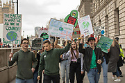 Young climate change protesters march along Whitehall on the 12th April 2019 in London in the United Kingdom.