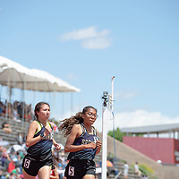 Kirtland Central runners LaKyle Yazzie, (6), and Aisha Ramone, (5), placed second and third in the 1600 meter race. The NMAA 4A State Track competition was held at the UNM Track & Field Complex in Albuquerque on Friday.