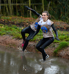 **EXCLUSIVE** ©  London News Pictures. 02/11/2013. Dani Emery (right), Girlfriend of Manchester united player Ben Amos tackling part of the course. Wives and girlfriends of Premiership football players do part of the famous Tough Guy event in Wolverhampton, UK. Mandatory photo credit : Mike King/LNP