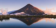 Mount Taranaki across Pouakai tarns in sunset light, Pouakai track, Egmont National Park, New Zealand Ⓒ Davis Ulands | davisulands.com