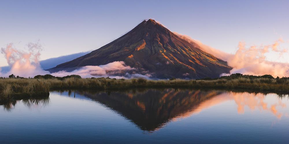 Mount Taranaki across Pouakai tarns in sunset light, Pouakai track, Egmont National Park, New Zealand Ⓒ Davis Ulands   davisulands.com