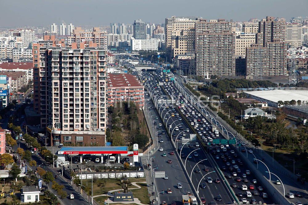 Traffic move through downtown Shanghai, China on Thursday, 13 january 2011. Shanghai will likely levy a 0.4-0.8 percent property tax next year to second homes and new homes exceeding a preset space limit, as another attempt to adjust growth and close wealth gap.