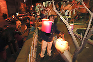 """Bolivia. Tarija. Festa di San Roque..The  '""""enfarolamiento"""" is a tradition that refers to the times when there was no public lighting, and party nights were illuminated by these colored paper lanterns hung in large quantities in the square Campero."""