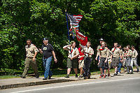 Wayne Bartlett joins Belmont Boy Scout troop 65 as they walk back to rededicate the War Memorial next to Belmont Library following the Memorial Day parade Monday afternoon.  (Karen Bobotas/for the Laconia Daily Sun)