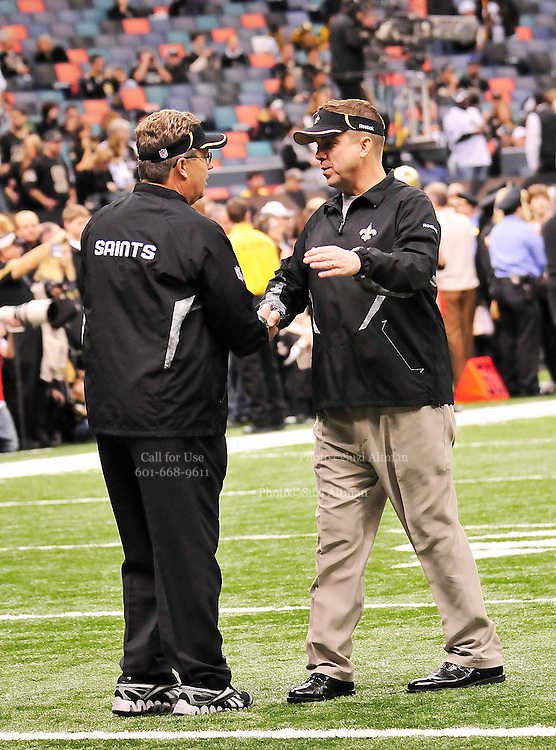 """File-Greg Williams, Defensive Coordiantor for the New Orleans Saintshas been suspended indefiently from the NFL  because of his """"bounty system"""" he had in place while coaching for the Saints during the 2009,2010 & 2011 NFL seasons. Coach Sean Payton was suspended for one year and General manager Micky Lookis was suspended for 8 games for thier roles in the """"Bounty scandal"""". File Photo of Defensive coach Greg Willams and coach Sean Payton shake hands before the Saints pre season game against the San Diego Chargers Friday Aug 27,2010. The San Diego charges cut Drew Brees a few years ago, allowing him to be picked uop by the Saints as a free agent. The Saints won 36-21 at half time.Photo© Suzi Altman"""