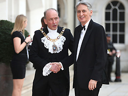 Lord Mayor of the City of London, Charles Bowman greets Chancellor of the Exchequer Philip Hammond at the Commonwealth Heads of Government banquet at the at Guildhall in London during the Commonwealth Heads of Government Meeting biennial summit.