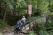 A mother pushes her childs buggy on a footpath in the Tatra National Park, on 16th September 2019, near Koscielisko, Zakopane, Malopolska, Poland.