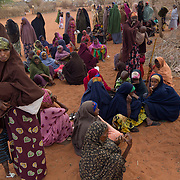 Women wait for relief distribution with their children during the East African drought. Wajir, North Eastern Province, Kenya.