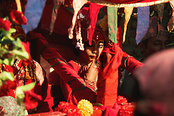 Kumari Dangol, 9, of Tokha, became a living goddess as an infant. A kumari's eyes are believed to draw the beholder into direct contact with the divine. For religious festivals her forehead is painted red, a sign of creative energy.