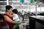 Husband and wife team Fan Yi and Zhang Jie with their daughter  in Hangzhou, China on 07 September 2014.