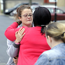 © Licensed to London News Pictures. 15/08/2012. Natalie Sharp, mother of Tia Sharp, being hugged by a friend at a memorial for the 12 year old on The Lindens, New Addington on August 15, 2012. Tia's mother Natalie Sharp and Tia's Step Father David Niles visit the memorial for half an hour as Tia's Step Grandfather, Stuart Hazell appeared at the Old Bailey by video link charged with murder. Photo credit : Grant Falvey/LNP