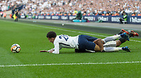 Football - 2017 / 2018 FA Cup - Semi-Final: Manchester United vs. Tottenham Hotspur<br /> <br /> Antonio Valencia (Manchester United) grabs a hold of the legs of Dele Alli (Tottenham FC)  to prevent him from breaking away at Wembley Stadium.<br /> <br /> COLORSPORT/DANIEL BEARHAM