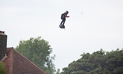 © Licensed to London News Pictures. 04/08/2019. Dover, UK. French inventor Franky Zapata gestures comes in to land at St Margarets Bat near Dover after crossing the English Channel on his jet-powered hoverboard. He is hoping to make the 35km crossing with a refueling stop mid channel to reach the English coast after setting off at 6am French time. Photo credit: Peter Macdiarmid/LNP