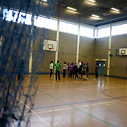 BELFAST, NORTHERN IRELAND - NOVEMBER 15, 2015: A children's mixed-race basketball team during practice at Olympia Leisure Centre in Belfast. The team, sponsored by local several social and integrations groups, is trained by coach David Cullem, a former player from Northen Ireland national team. CREDIT: Paulo Nunes dos Santos for The New York Times