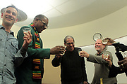 Brooklyn, New York, NY-February 8: (L-R) Author/Photographer Jamel Shabazz, Author/Photographer Joseph Rodriguez along with Publisher Daniel Powers do a toast backstage during Visually Speaking! The People's Photographer curated by Terrence Jennings for the Brooklyn Public Library on February 8, 2018 in the Brooklyn section of New York City.  The Visually Speaking! series is a platform for Photographers highlighting visually important photographic works. (Photo by Terrence Jennings/terrencejennings.com)