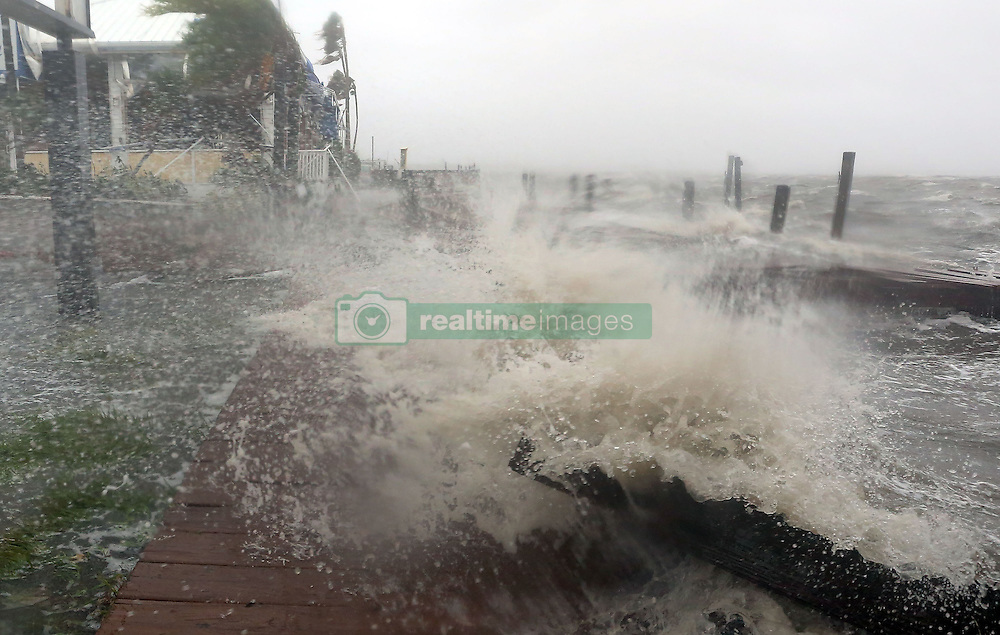 October 7, 2016 - Cocoa Beach, FloridaL, U.S. - Surf from the Banana River crashes up on a dock at Sunset Grill Thursday in Cocoa Beach as the Category 4 Hurricane Matthew hit Florida's east coast. (Credit Image: © Red Huber/TNS via ZUMA Wire)