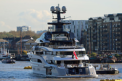 © Licensed to London News Pictures. 04/11/2014. The beautiful superyacht Kismet glistens in the autumn sunshine in London today. The vessel is widely reported to be owned by Shahid Khan,  the owner of Premier League football club, Fulham FC. He also owns the NFL team the Jacksonville Jaguars and today a brand new, opulent silver Jaguar mascott was attached to the bow of the superyacht along with a silver NFL helmet. Khan is reported to have a Khan's net worth over $4.6. billion Credit : Rob Powell/LNP