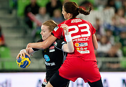 Karoline Breivang of Larvik vs Andrea Penezic of Krim during handball match between RK Krim Mercator and Larvik HK (NOR) of Women's EHF Champions League 2011/2012, on November 13, 2011 in Arena Stozice, Ljubljana, Slovenia. (Photo By Vid Ponikvar / Sportida.com)