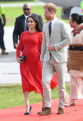 Prince Harry Duke of Sussex and Meghan Duchess of Sussex arrive at Tonga Airport to begin their tour of the Kingdom. Photo credit should read: Doug Peters/EMPICS