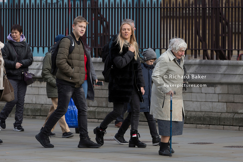 The veteran Liberal Democrat politician, Baroness Williams of Crosby, Shirley Williams, walks unnoticed by others with the aide of a walking stick towards the House of Lords, on 14th January 2019, in Westminster, London, England.