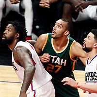 25 April 2017: Utah Jazz center Rudy Gobert (27) vies for the rebound with LA Clippers center DeAndre Jordan (6) and LA Clippers guard Austin Rivers (25) during the Utah Jazz 96-92 victory over the Los Angeles Clippers, during game 5 of the first round of the Western Conference playoffs, at the Staples Center, Los Angeles, California, USA.