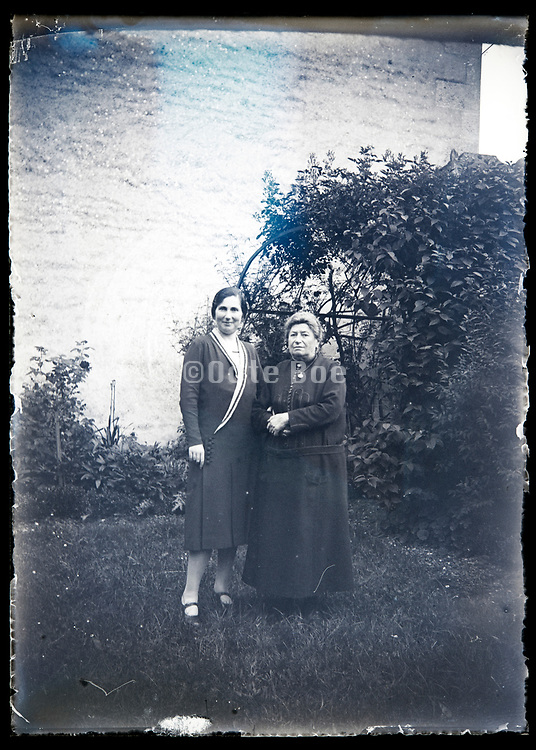 two generation women standing in backyard garden France circa 1930s