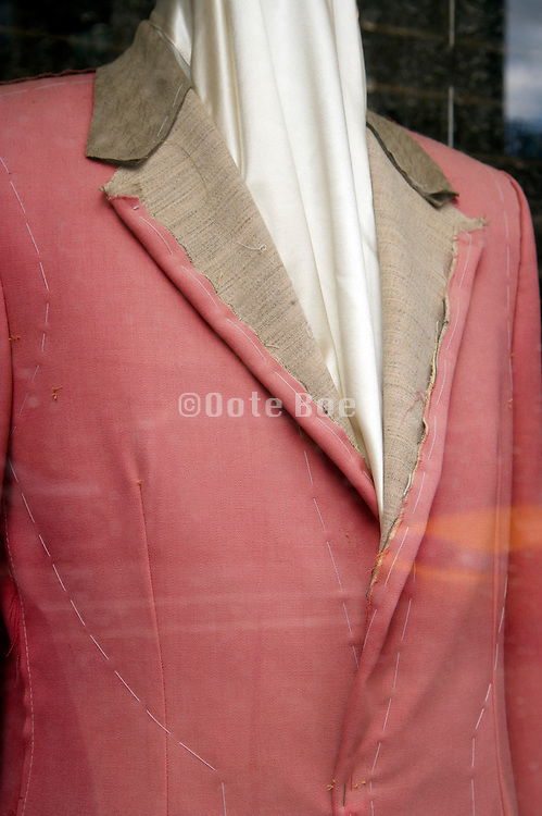 close up of tailors costum made jacket displayed in window