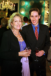 SUSAN, VISCOUNTESS HEREFORD and her son the HON.ROBIN DEVEREUX,  at a party in London on 25th November 1999.MZK 54