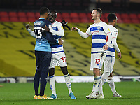 Football - 2020 / 2021 Sky Bet Championship - Watford vs Queens Park Rangers - Vicarage Road<br /> <br /> Albert Adomah of Queens Park Rangers (middle) congratulated by Dominic Ball and Seny Dieng (left) at the final whistle.<br /> <br /> COLORSPORT/ASHLEY WESTERN