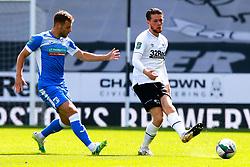 Craig Forsyth of Derby County gets the ball away from James Jones of Barrow - Mandatory by-line: Ryan Crockett/JMP - 05/09/2020 - FOOTBALL - Pride Park Stadium - Derby, England - Derby County v Barrow - Carabao Cup