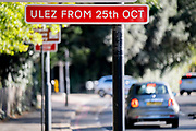 Transport for London's (TFL) new signposts for the new Ultra Low Emissions Zone (ULEZ) have been erected around the inner orbital road perimeter around the capital, and seen on the South Circular in Dulwich on the day that the new area becomes effective for newer vehicles, on 25th October 2021, in London, England. Now 18 times larger, the new ULEZ area bans older vehicles such as polluting diesels and petrol cars older than 2006, an attempt to lower poisonous emissions that further harm the health of 1 in 10 children who have asthma. Drivers of non-exempt vehicles may enter the ULEZ after paying a £12.50 daily fee - or face a £160 penalty.